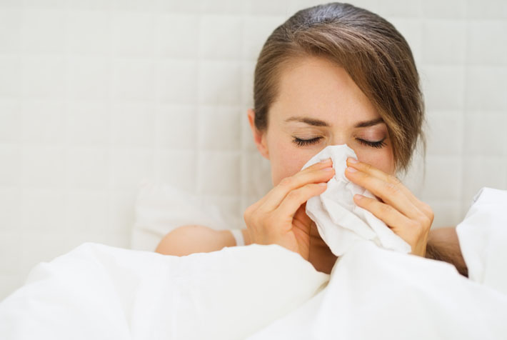 Woman suffering from the flu